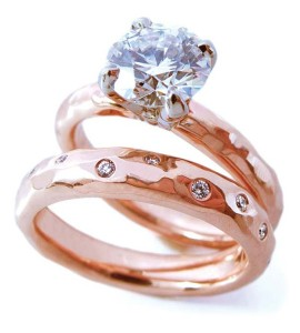 Hand-hammered 14-karat rose gold engagement ring by Shelly Purdy, featuring a 1.50-carat Canadian diamond. Matching wedding band set with 19 diamonds (.45 ctw).