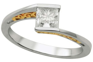 Two-tone 14-karat gold solitaire diamond engagement ring by Master Design, with one-carat Canadian diamond.