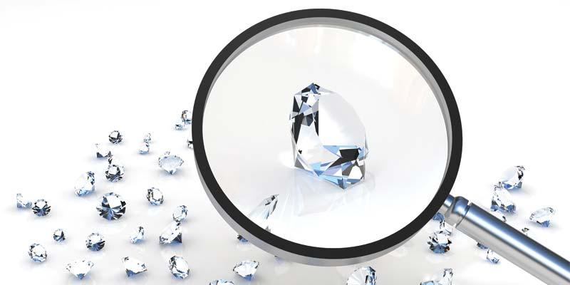 bigstock-Magnifier-and-brilliants---d-24975731