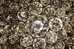 The irregular outline and shallow make of these old-European brilliant diamonds become apparent at higher magnification.