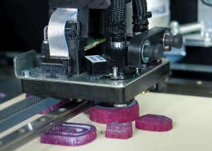 A 3-D printer builds wax models. Build times vary depending on the design's height.