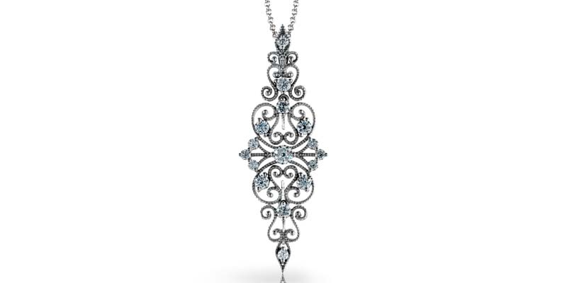 18-karat white gold pendant by Simon G, with round white diamonds (.69 ctw).