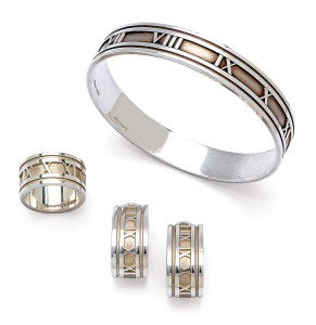 Sterling silver 'Atlas' bangle, ring, and ear clips by Tiffany & Co.