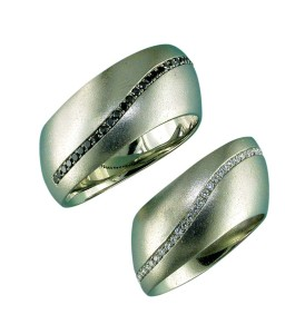 Offset bands offer a more interesting twist on the classic gold wedding ring. The amount of offset can be fitted to the actual shape of the client's hand.