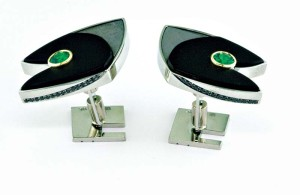 'Green Arrow' cufflinks in white gold, with black jade, meteorite, round bezel-set tsavorite garnets, and bead-set black diamonds.