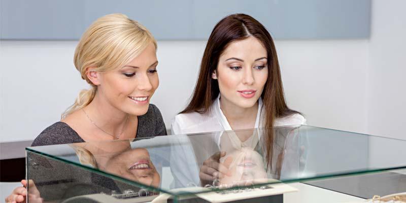 bigstock-Two-girls-looking-at-showcase--54199673