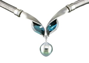 'Mood Indigo' pendant/clasp,with indicolite tourmalines (6.42 ctw) and one pear-shape diamond (.10 ctw) suspending a drop-shape South Sea pearl with turquoise overtone.