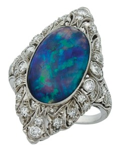 Simply because this platinum ring appears to be a vintage piece is no guarantee the opal centre stone is natural and/or hasn't undergone various potential treatments.