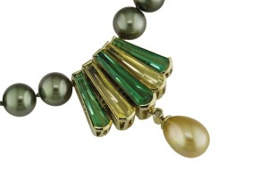 'Tierra' pendant clasp in 18-karat green gold set with green tourmaline, golden beryl, and accented with a yellow diamond and golden green South Sea pearl drop.