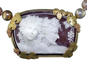 Antique shell cameo with 18-karat yellow, rose, and green gold grape leaves and red gold grape cluster accents.