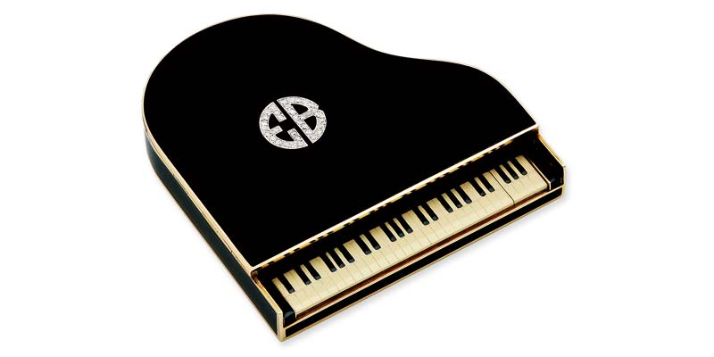 A 1930's art deco enamel, diamond,  and 14-karat gold figural piano compact once owned by concert pianist Ellen Ballon.