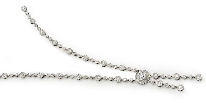 Modern lariat necklace with negligée design from Tiffany & Co.'s 'Circlet' collection, with diamonds in platinum.