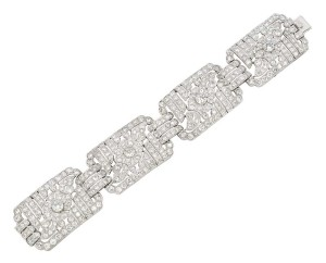 Art deco diamond and platinum multi-panel bracelet, with pierced floral and foliage design from Henri Lyon. French assay mark, circa 1920.