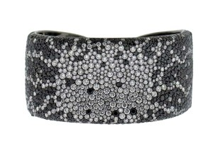 This labour-intensive black and white diamond cuff may be sold at a lower price point due to lower production costs in Asia. Its valuation should reflect that.