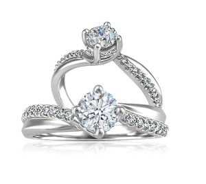 19-karat white gold ring by Beverly Hills Jewellers, with .70-carat round Canadian diamond centre and diamond sides.