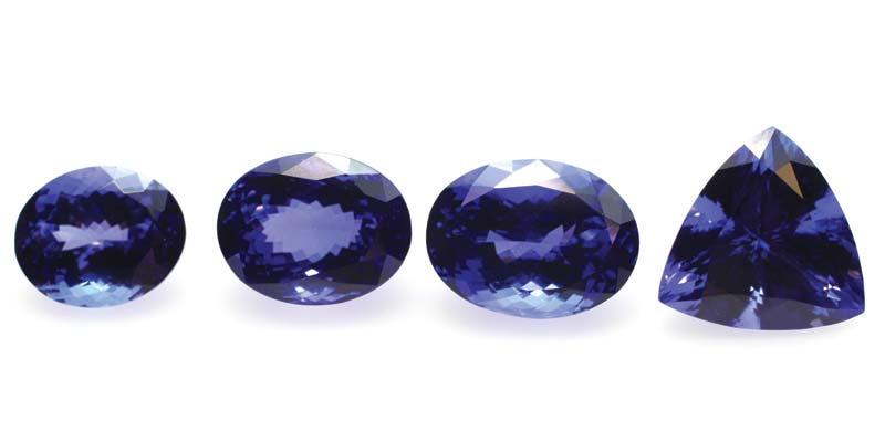 Four tanzanites ranging in colour from lighter violet-blue (8.43 carats far left) to dark bluish-violet (14.23-carats far right).