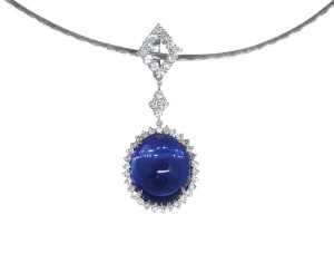 23-carat violetish-blue heated oval cabochon tanzanite set in a pendant.