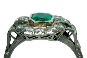 This vintage platinum ring was clearly altered; however, the quality of the gold used for the bezel setting cannot be tested. This example of a limiting condition should be disclosed even though it has minimal impact on value.