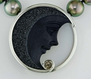A 1.02-carat fancy round-cut by Gabi Tolkowsky accents the black agate side of the pendant.