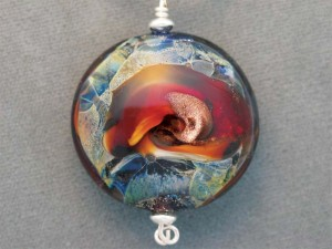 Jewellery artist Susan Stanford uses a small amount of cremains in the molten glass of her lamp-worked beads.