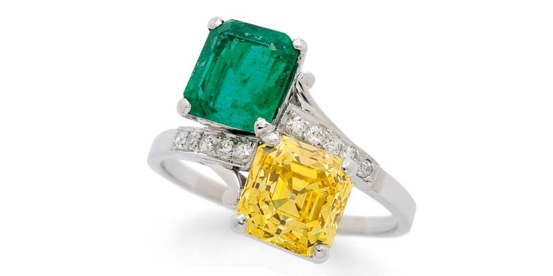 'Toi et moi' platinum ring by Birks, with a 3.12-carat Asscher-cut fancy vivid yellow diamond and a Colombian emerald.