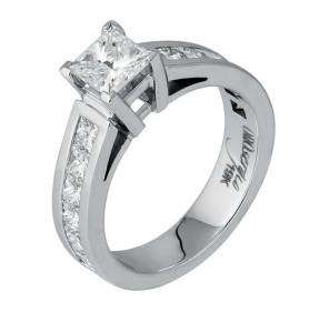 19-karat white gold ring by Orosergio, with 1.05-carat princess-cut diamond and 12 princess-cut sides (1.39 ctw).