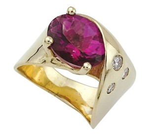 The centre stone in this custom-made ring was represented as a fine-quality rubellite tourmaline by the online seller; examination proved it to be a coated topaz.