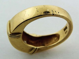 Although poor in quality, this yellow gold ring is an example of casting.  Note the telltale signs of cracking and pitting.