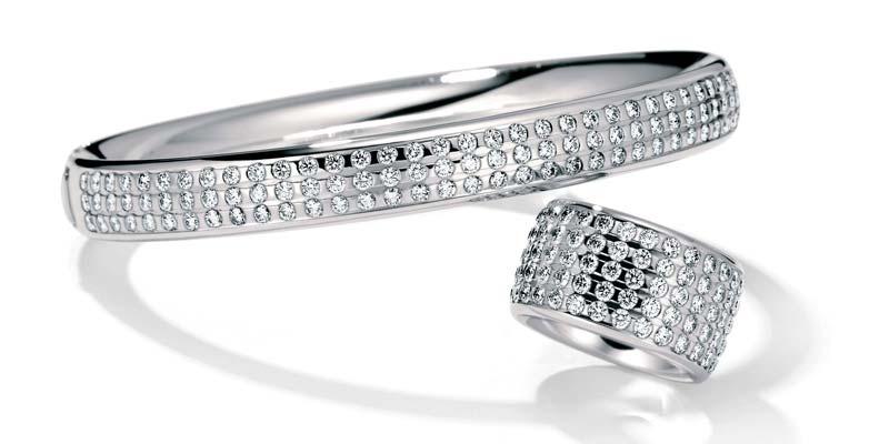 Platinum bracelet, with 99 brilliant-cut diamonds and platinum ring, with 84 brilliant-cut diamonds, both by Henrich & Denzel.