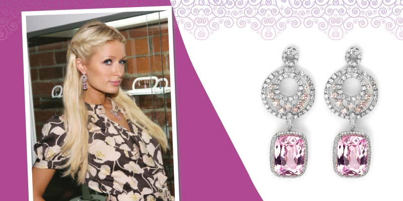 Paris Hilton wearing white gold 'Goddess Earrings' by Candy Ice Jewelry, with interchangeable pink topaz and diamond charms.