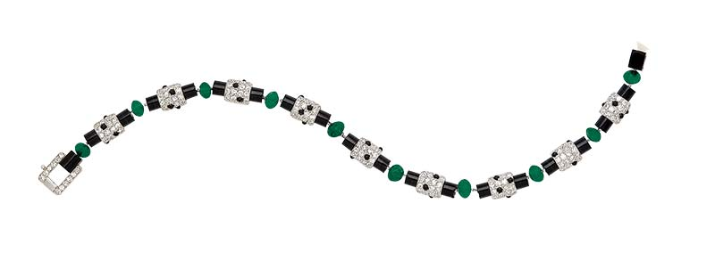 Signed art deco emerald, onyx, and diamond bracelet, circa 1920, by Cartier.