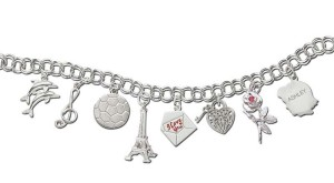Bracelet and assorted charms in sterling silver by Rembrandt Charms.