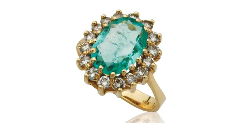 The owner of this 18-karat ring with a Colombian emerald found it difficult to understand the large window in the stone significantly impacted the market value.