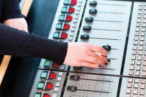 bigstock-Presenter-in-radio-station-hos-64908388