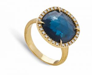 Hand-engraved ring with blue topaz and diamonds in 18-karat yellow gold by Marco Bicego.
