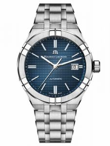 The AIKON Automatic by Maurice Lacroix features a water-resistant case, flexible five-link steel bracelet, six arms on the bezel, and date window on a blue dial.