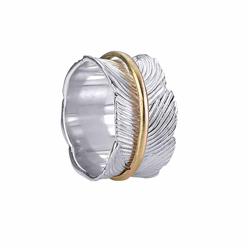 Sterling silver 'Eden' ring with brushed silver edging and leaf-patterned base along with brushed 10-karat yellow gold spinning band by MeditationRings. A finalist in the 2018 JCK Jewelers' Choice Awards.
