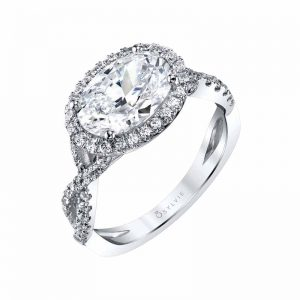Ring in 14-karat white gold with two-carat oval diamond centre (0.38 ctw) by Sylvie Collection.