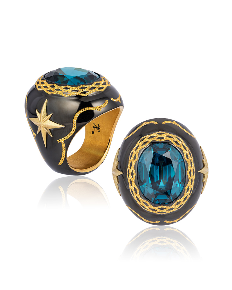 First Place: Zoltan David – Steel and 24-karat gold ring featuring a 25.53-carat blue zircon.