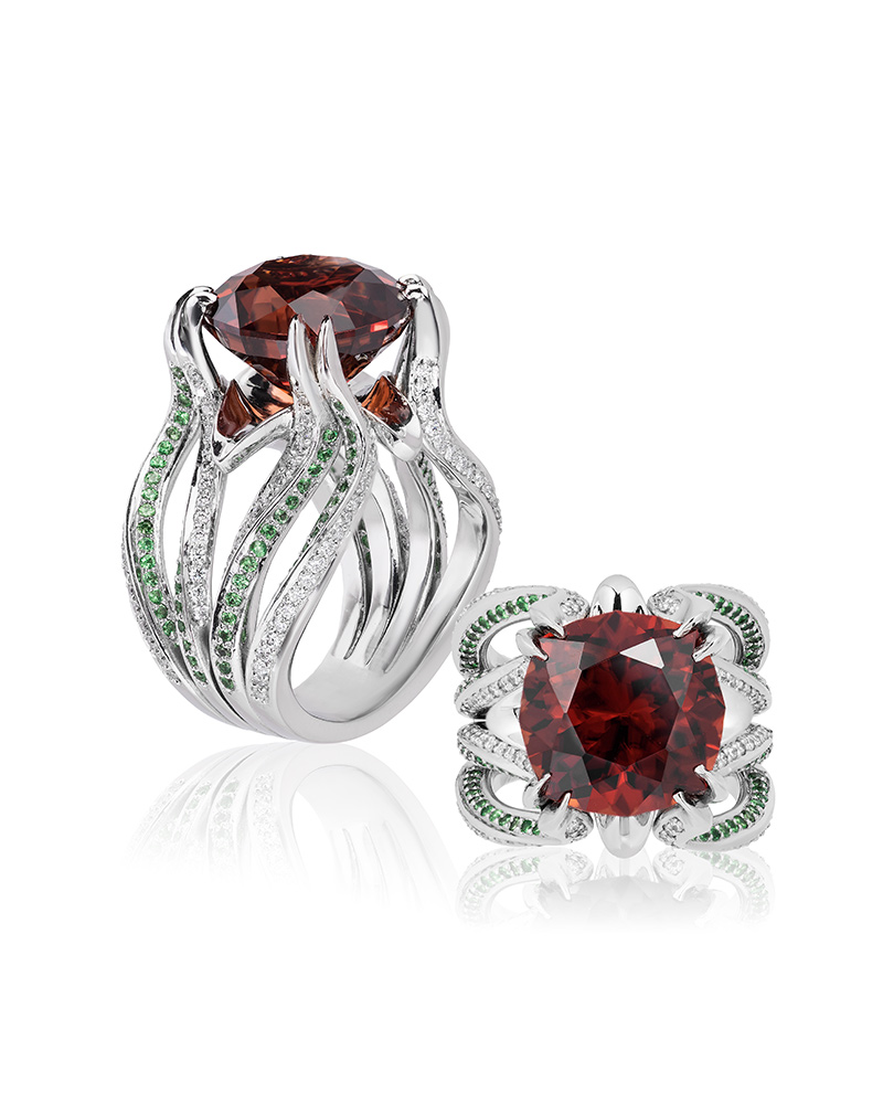John Haynes, Schmitt Jewelers – Platinum 'Solar Blossom' ring featuring a 14.73-carat orange zircon accented with tsavorite garnets (0.67 ctw) and diamonds (0.65 ctw).