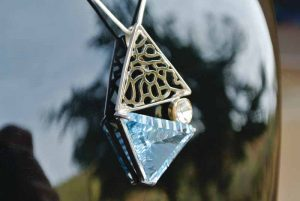 This 'Minds at Work' pendant incorporates sliced diamond and blue topaz combined with both 18-karat gold and sterling silver. Photos courtesy Neeta Gupta