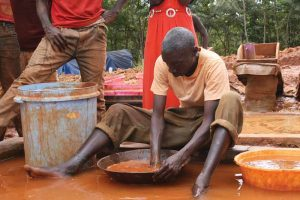 A miner in Tanzania mixes mercury and gold.