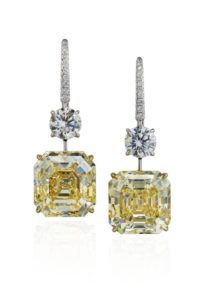 These earrings feature two yellow diamonds: one weighing 13.35 carats and the other weighing 12.03 carats. Photo © Christie's