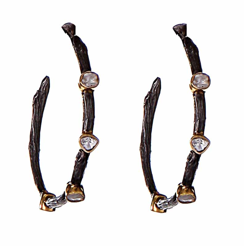 Black-plated earrings inspired by the concept of the circle of life, made in 18-karat gold, sterling silver, and sliced diamonds, by Neeta Gupta. MSRP $1899