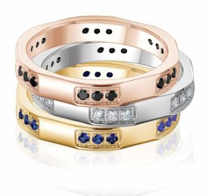From the 'Haute Couture' collection by Gravure Commitment/Atlantic Engraving, stackable rings available in 10-karat rose, white, or yellow gold with black diamonds, white diamonds, or blue sapphires. MSRP $1100, $730, $760 (from top to bottom) Contact: Gravure Commitment/Atlantic Engraving (800) 267-7823