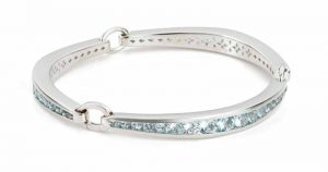 'Trinity' bracelet in sterling silver with blue topaz by KIR. MSRP $738