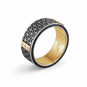 Comfort-fit, 8-mm carbon fibre wedding band with yellow gold inlay, topped with small screws on a golden plate, by Malo Bands. MSRP $1875
