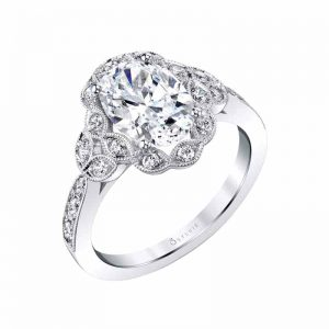 14-karat white gold engagement ring (0.29 ctw) with floral halo and milgrain beaded petals surrounding one-carat oval centre by Sylvie Collection. MSRP $2385