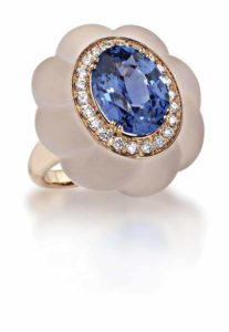 Rose gold ring by Picchiotti featuring an oval Sri Lanka sapphire weighing more than seven carats, encircled by a diamond line and surrounded by satin-finish rock crystal.
