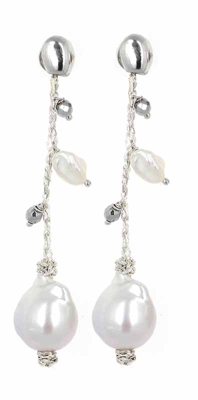 Sterling silver earrings from Pesavento's 'DNA Shine' pearl collection, featuring baroque pearls bound together with silver thread.